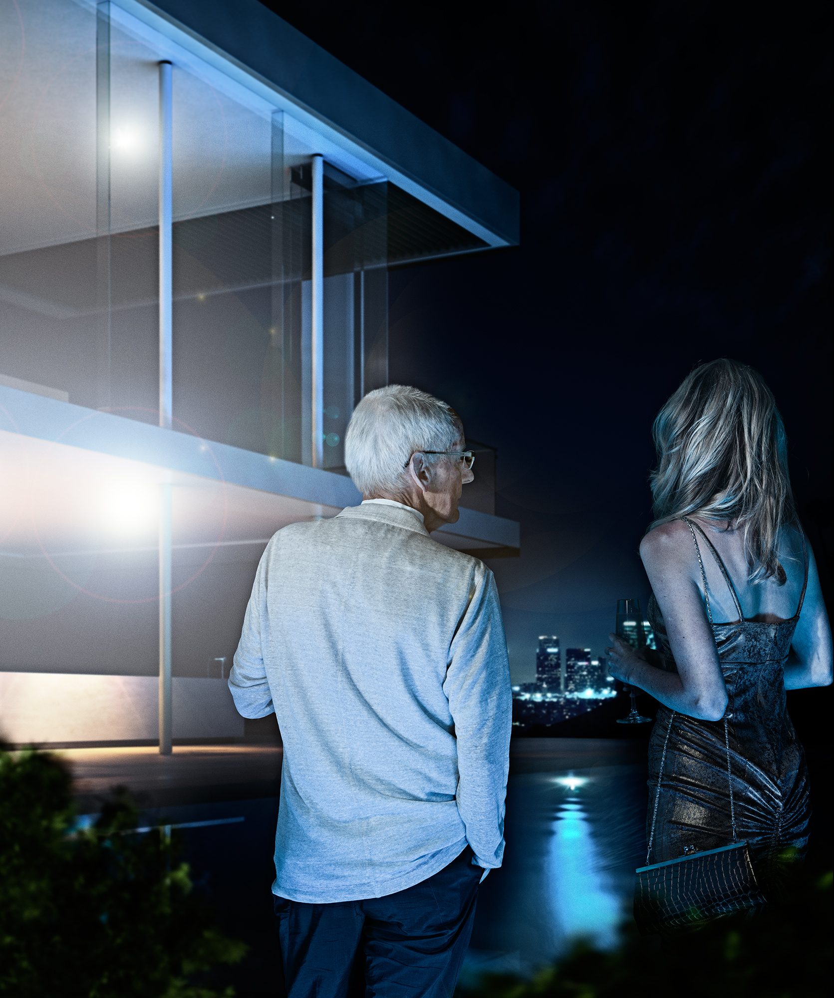 BKOZKA_a successful older man talks to an attractive woman while standing by the pool_2015.jpg