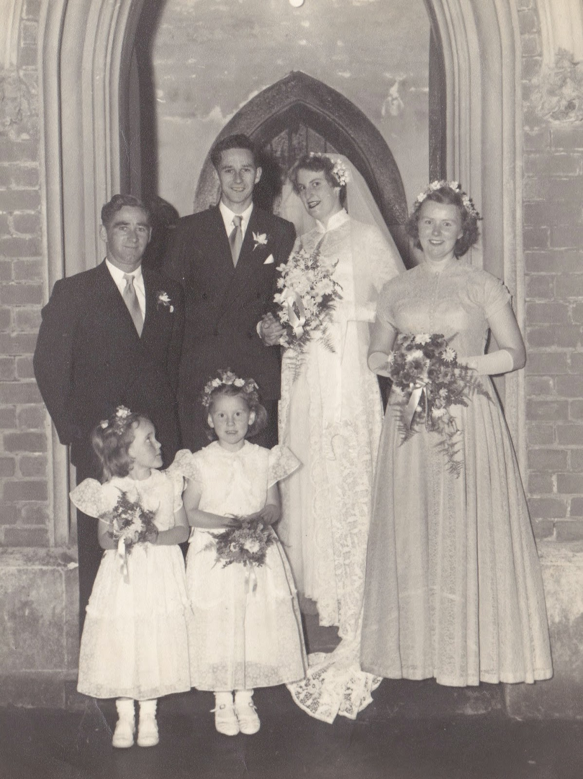 My cute little sister Linda and me are the Flowergirls at our Aunty's Wedding 1951