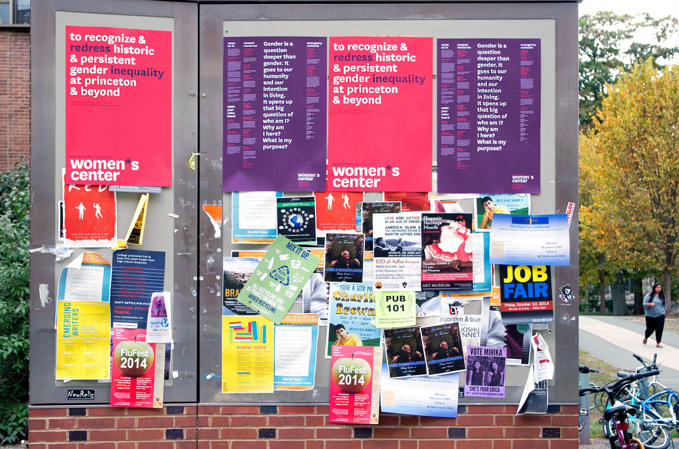 Women*s Center calendar posters hung outside of Frist.