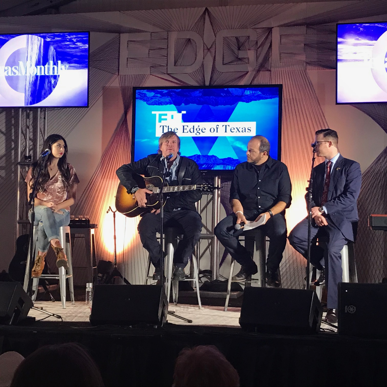 Mignon, Jack ingram, Andy langer, and Jefferson Clay on stage at the Edge of Texas event in dallas.