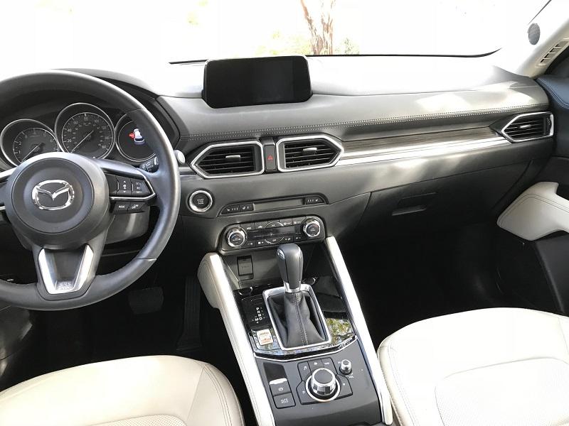 I like Mazda's Command Control knob for the on-screen menu. So easy.
