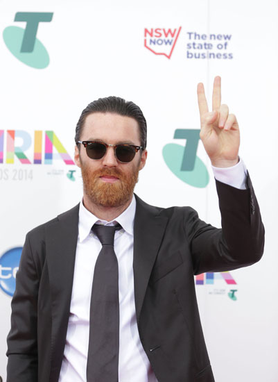 The real Chet Faker stands up.