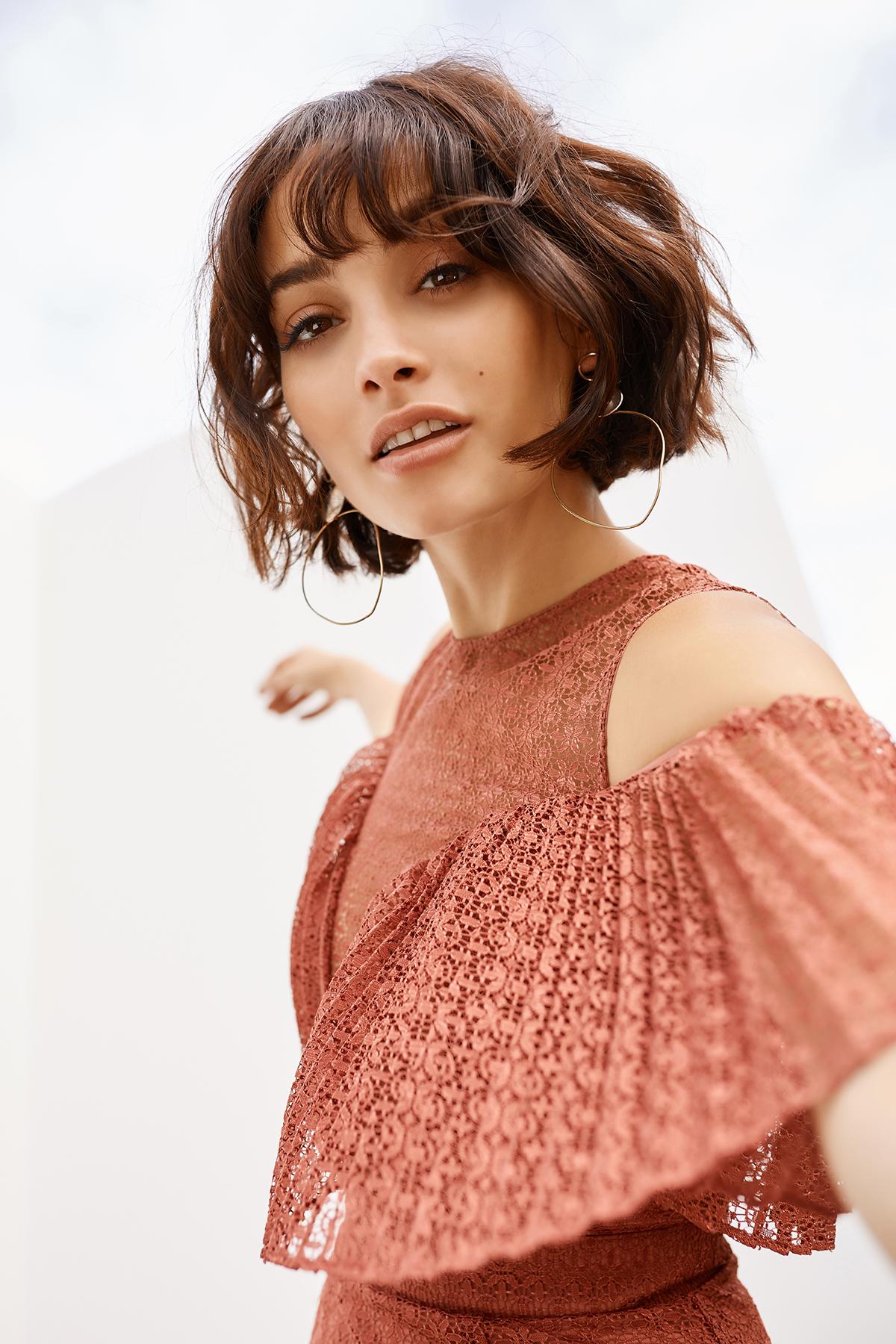 Taylor wears Keepsake Ignite Mini Dress. shop now.