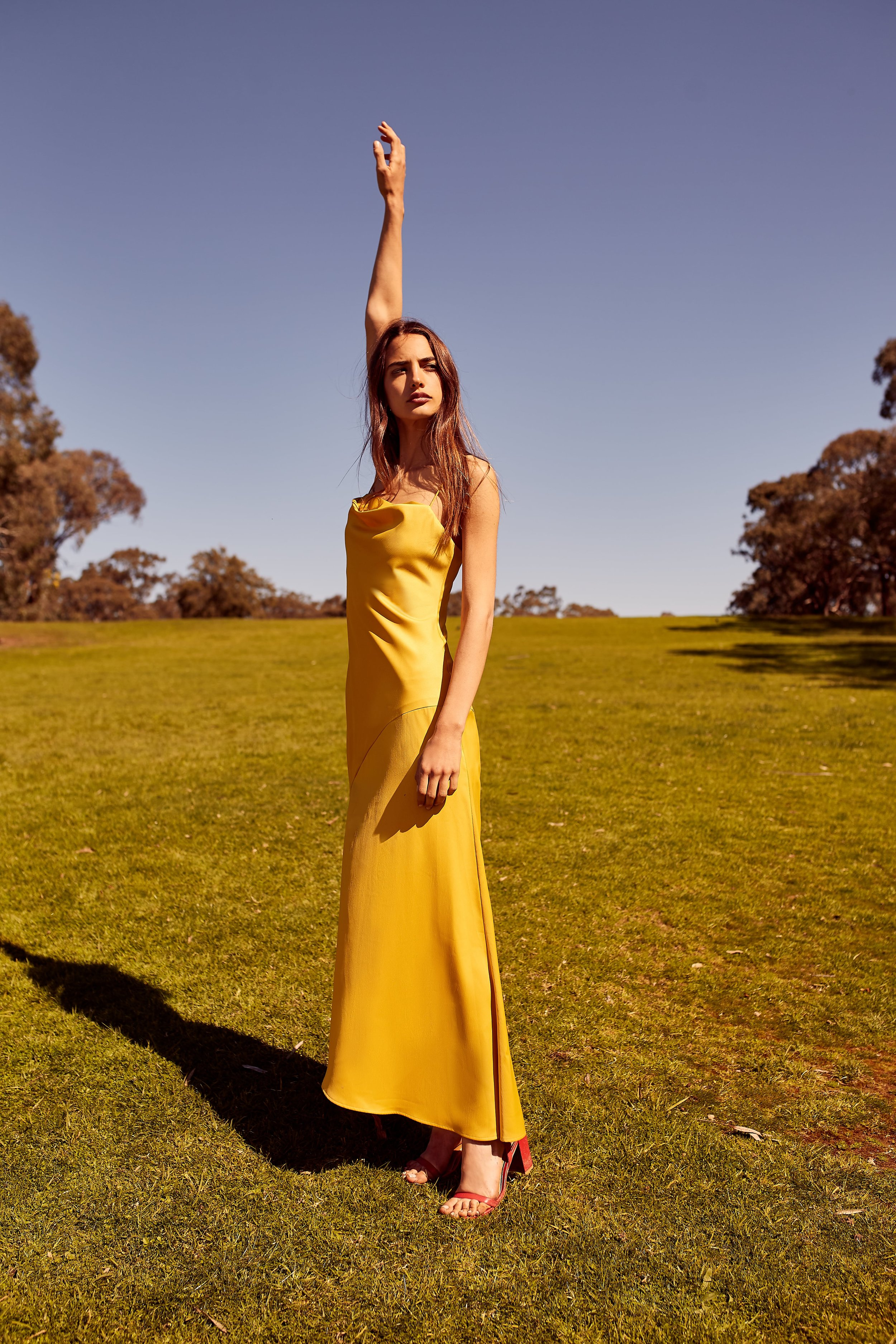 Mili wears C/MEO All Right Now Gown.