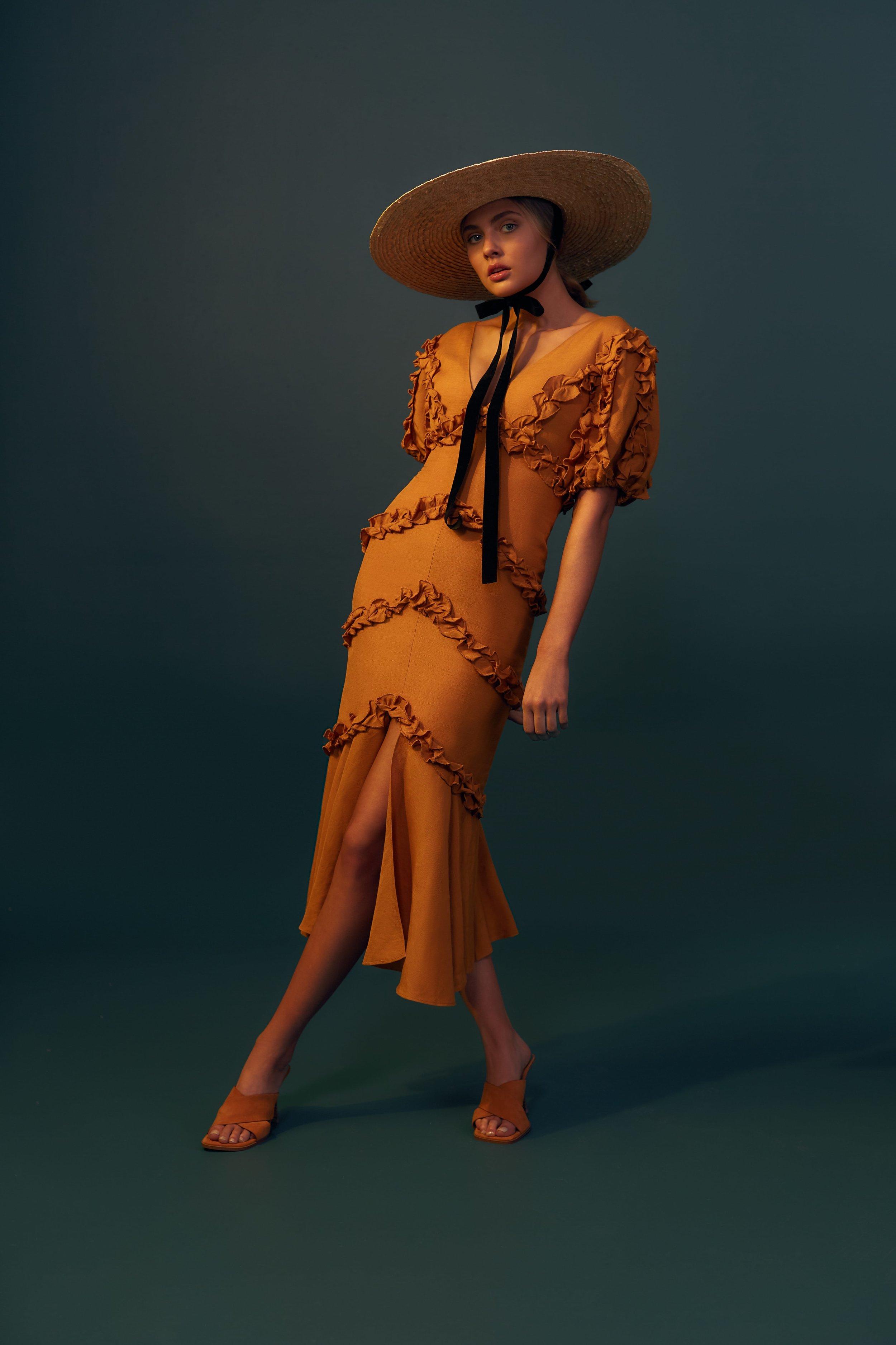 Kerryn wears C/MEO Thousand Times Midi Dress.