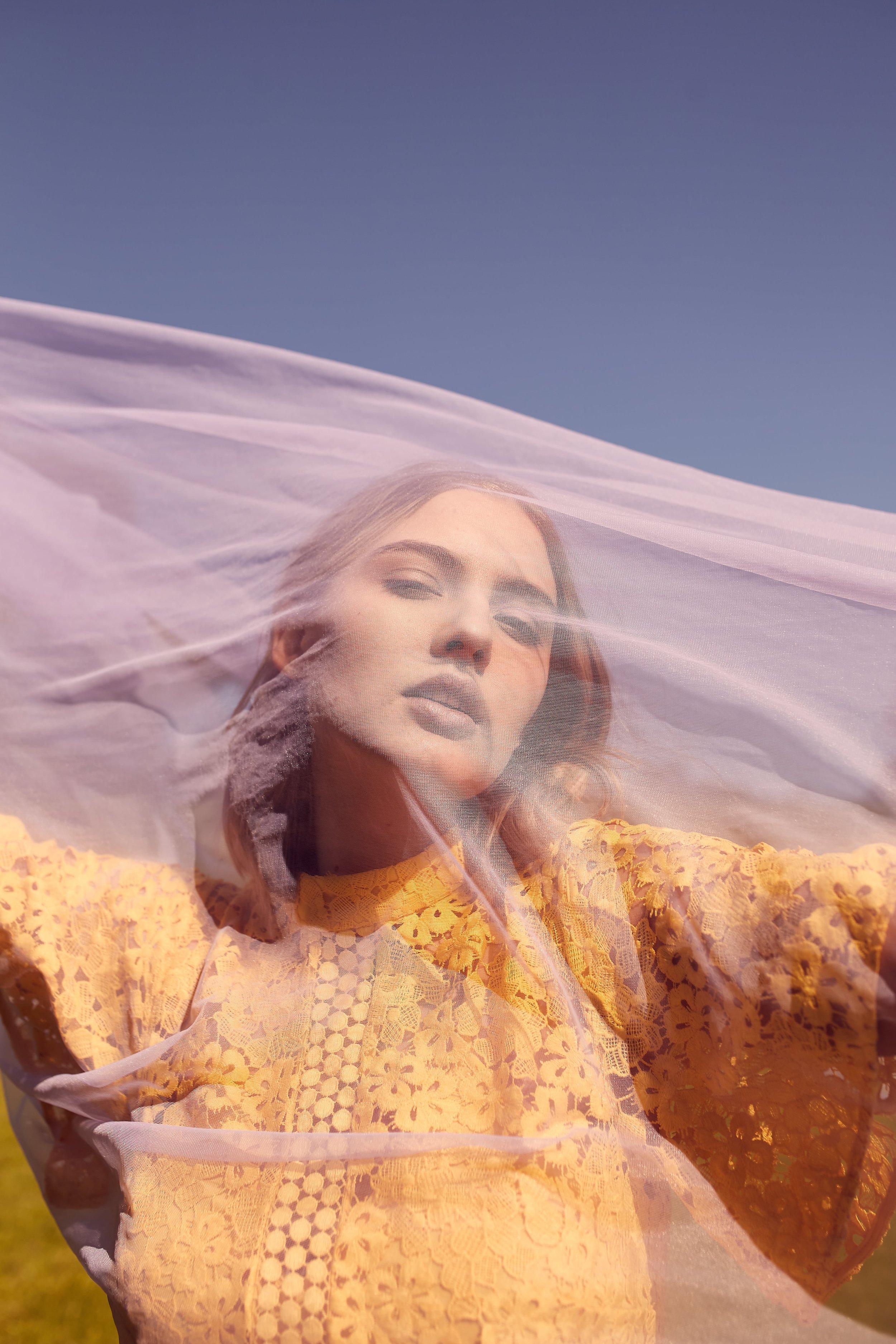 Kerryn wears Keepsake Utopia Lace Midi Dress.
