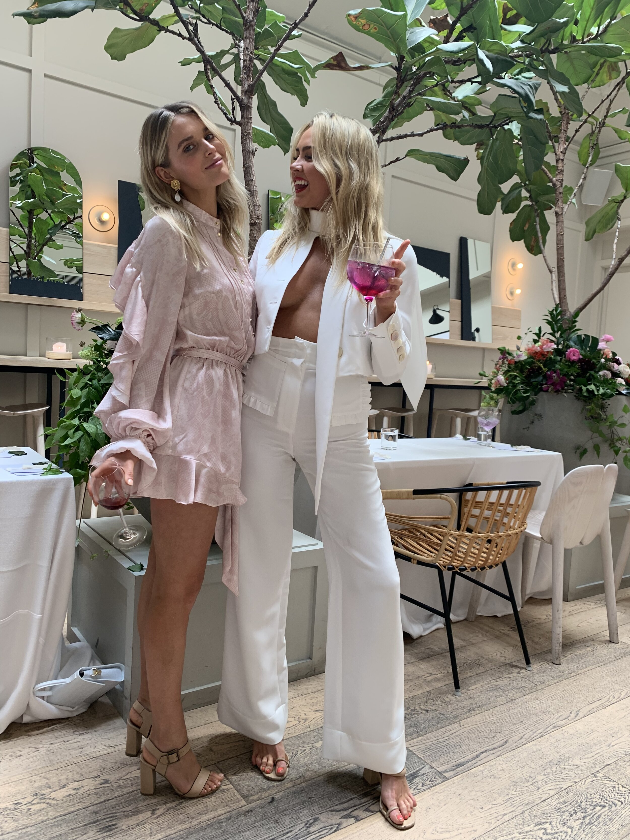 @ebonylet (left) wearing Pearl Playsuit and (right) @nikkiholdennn wearing the Entrancing Jacket and Pant