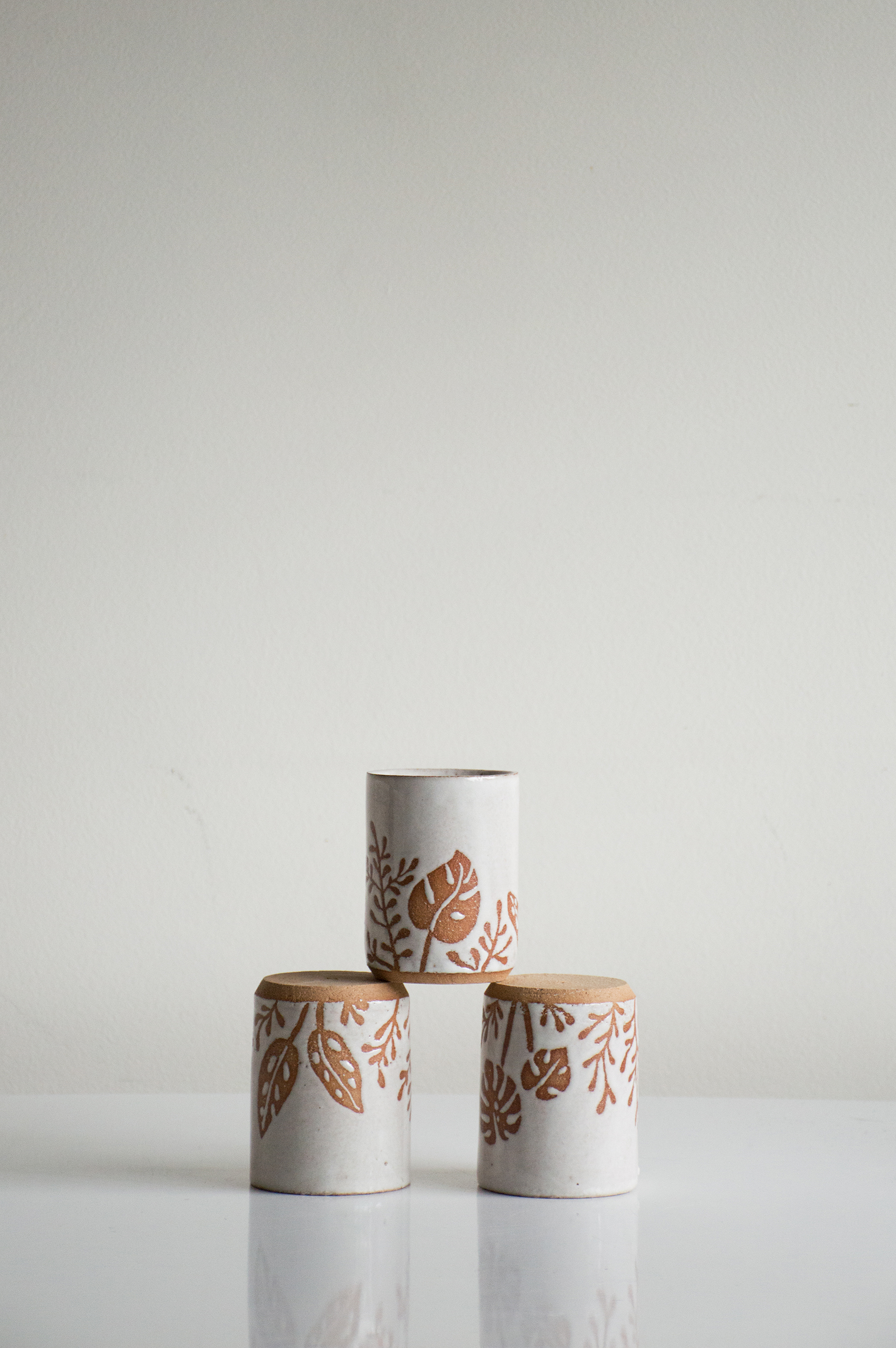 Botanical tumbler - Petite vessel patterned with philodendrons, smoke plant and palm leaf.Dimensions | 3