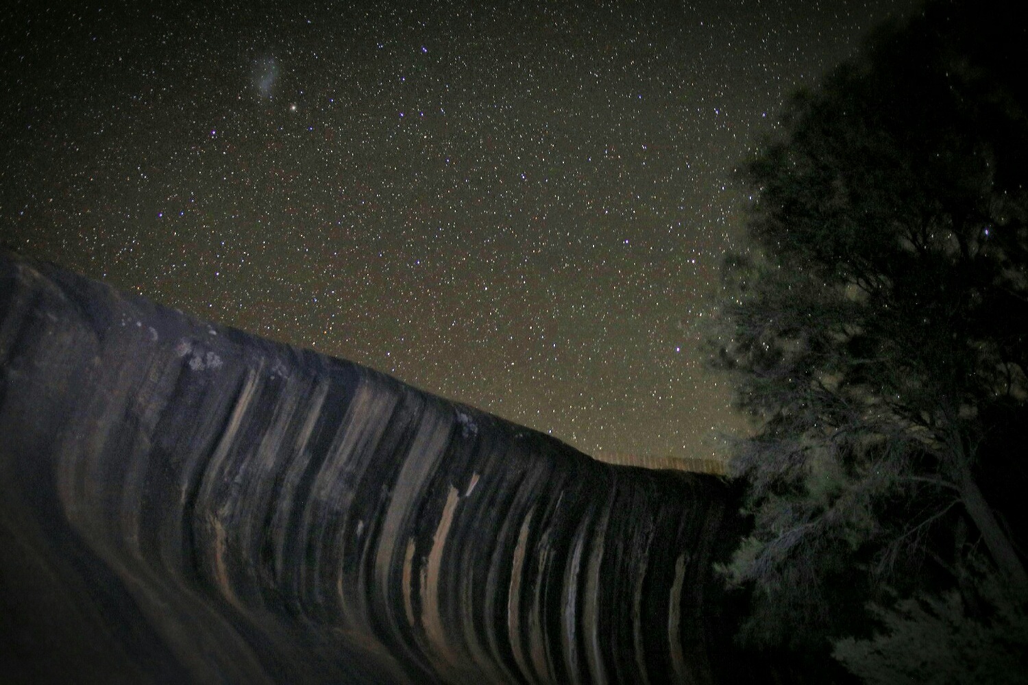 Wave Rock against a starry night