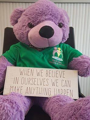 Teddy with sign.jpg