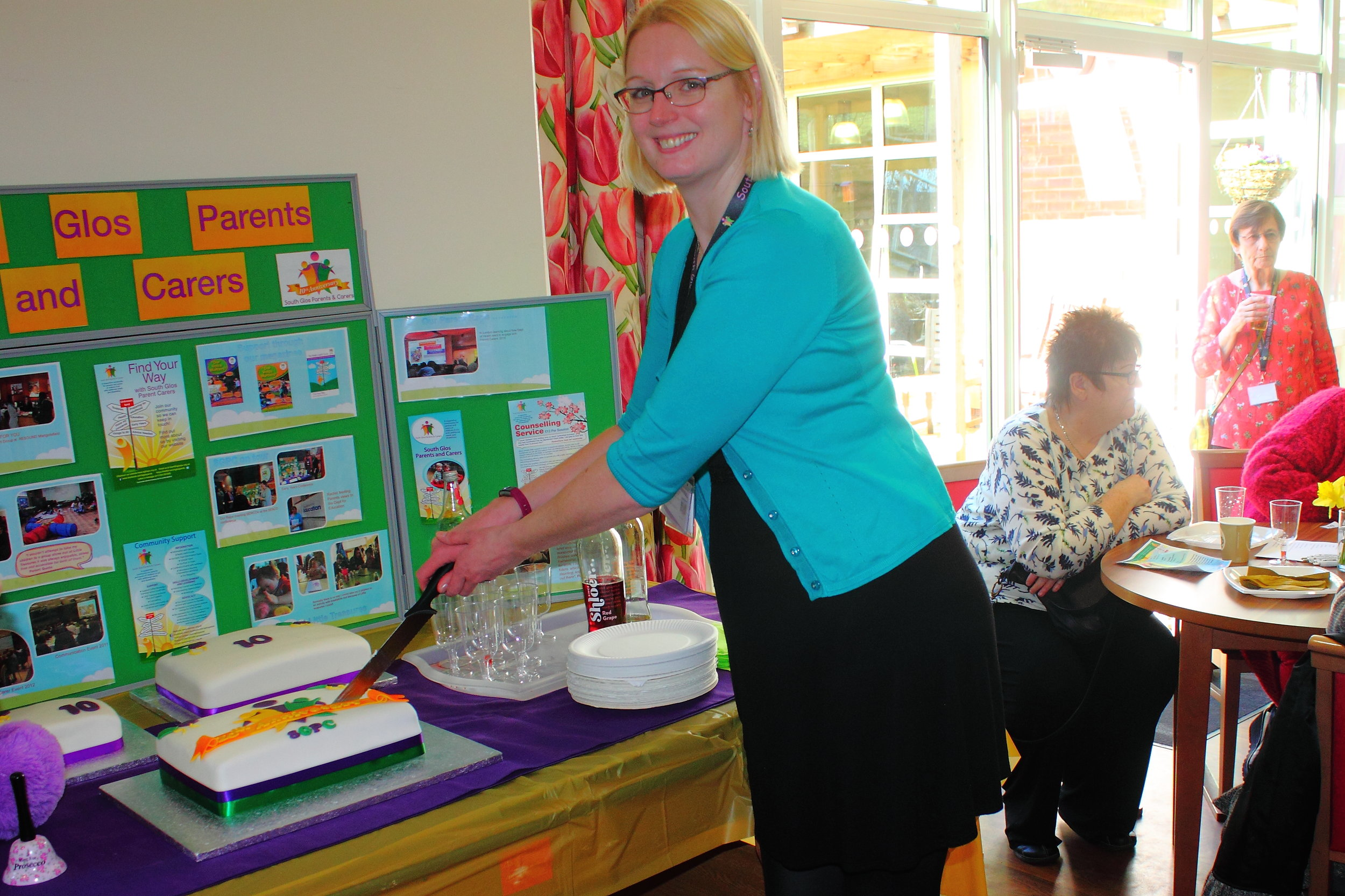 Caz is cutting the first of 3 wonderful cakes baked and decorated by our Early Years Specialist and all round fantastic artist Gill Robbins