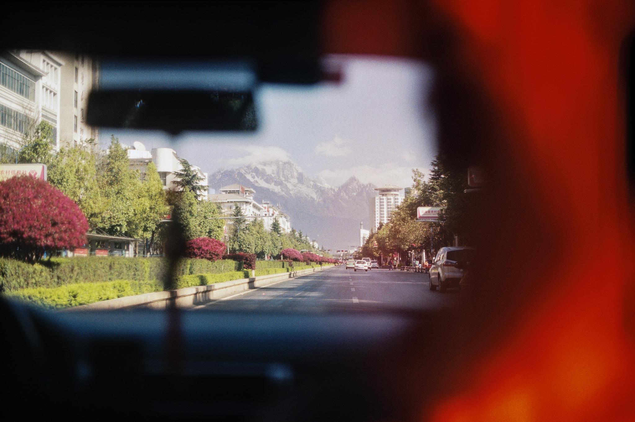 Backseat of a Taxi through Lijiang