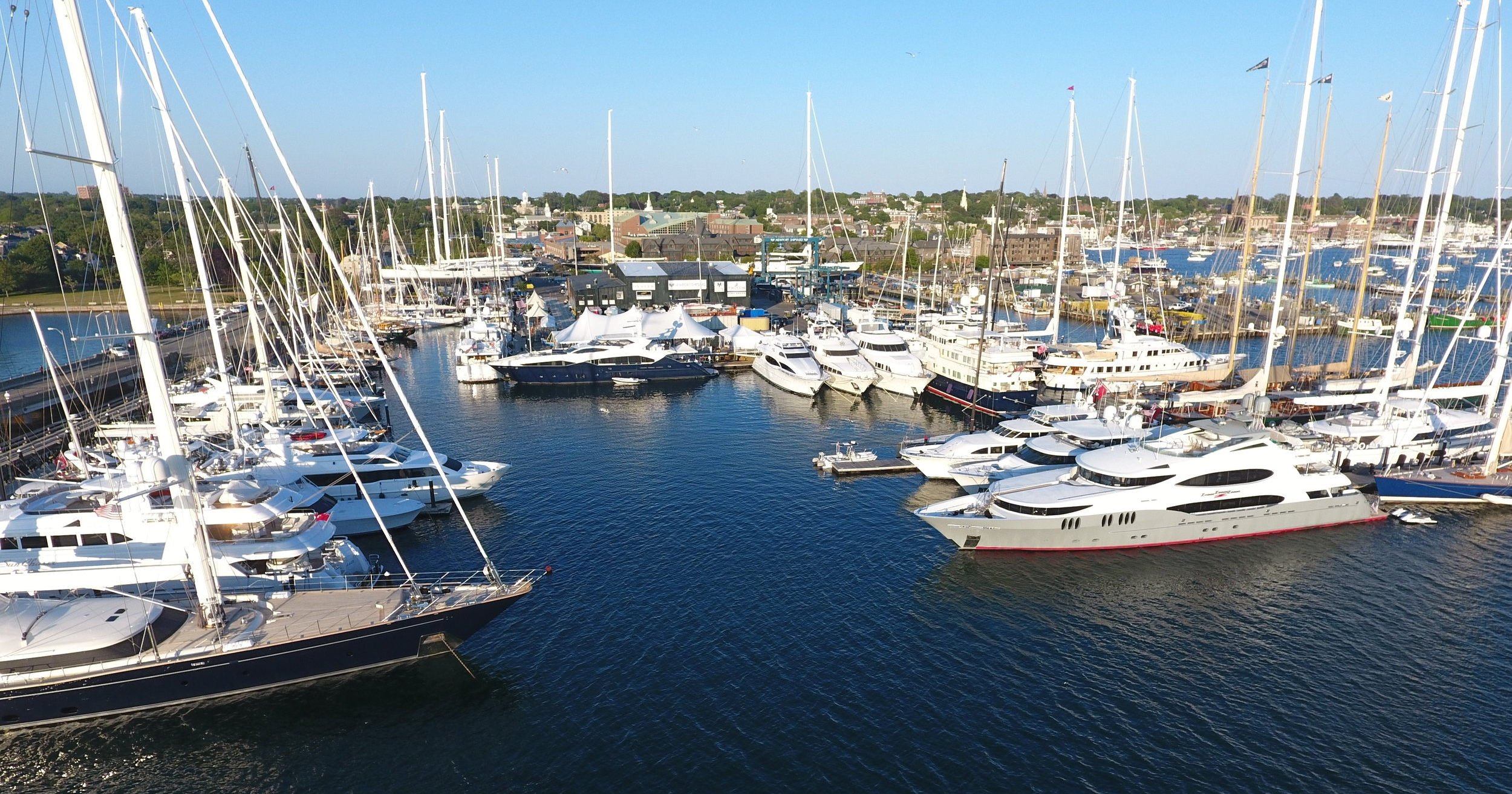 Newport Shipyard, which hosts and services visiting superyachts year-'round, is the home of Newport Charter Yacht Show presented by Helly Hansen. (photo by Billy Black)