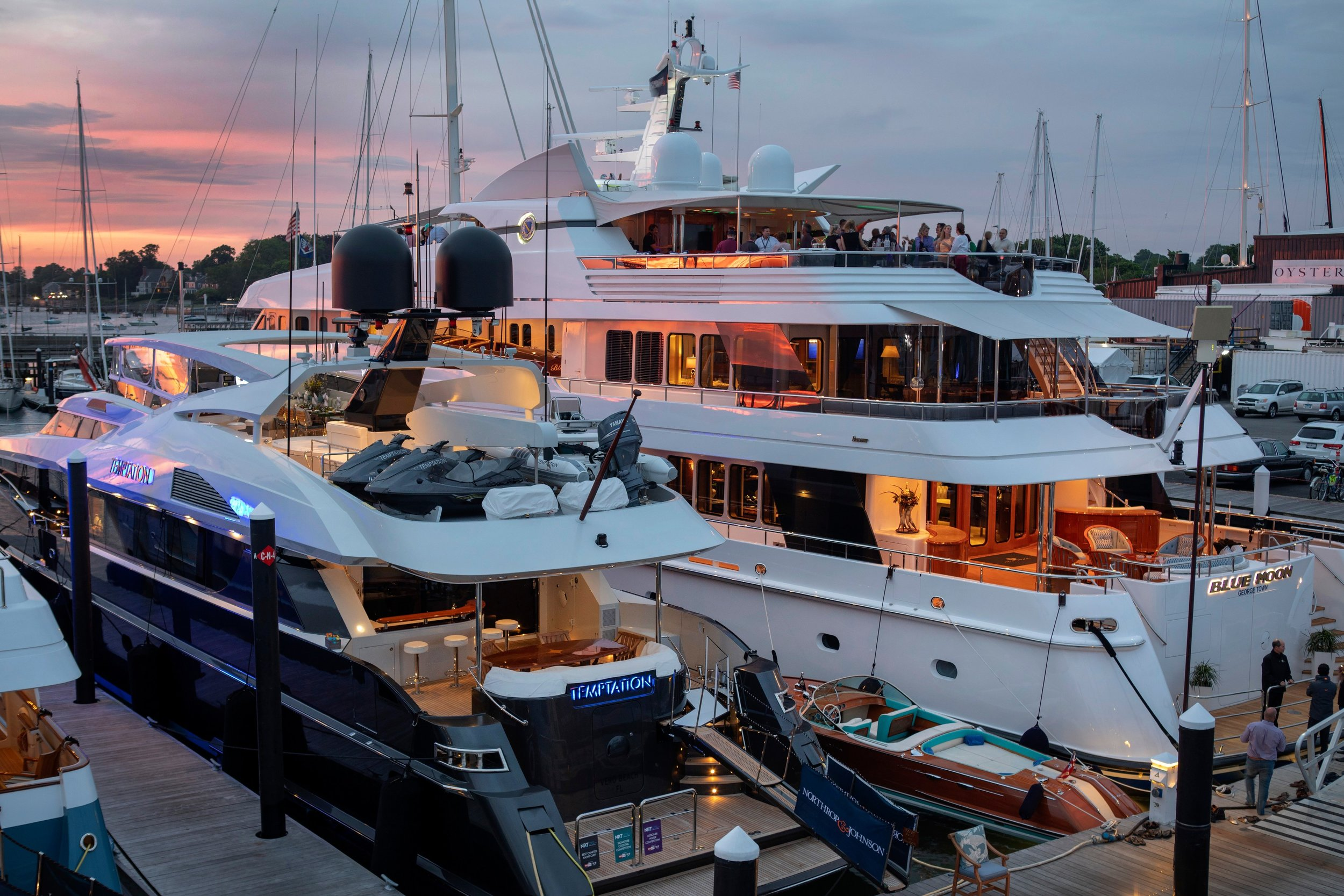 The 123' motor yacht  Temptation and the 198' motor yacht  Blue Moon represented some of the diverse chartering options in New England at the 2018 Newport Charter Yacht Show presented by Helly Hansen Newport.(photo credit: Billy Black)