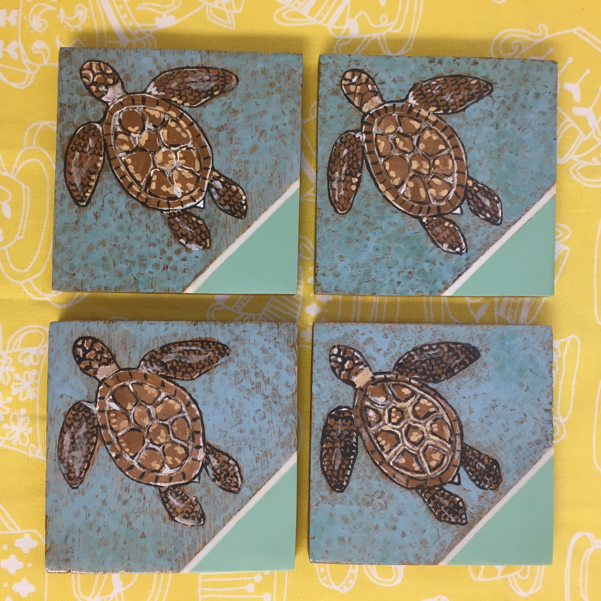 4.5 inch Sea Turtle Coaster Set - Keeping your table protected against moisture from glasses never looked so pretty! This set of four Sea Turtle coasters features a decorative sea foam and white inset on wood coasters with skid proof feet. Painted with milk paint and sealed with hard coat. These coasters are for decorative purposes only and not suitable for direct food contact. Wipe clean with a damp cloth, do not soak or put in the dishwasher.$25, plus sales tax and shipping