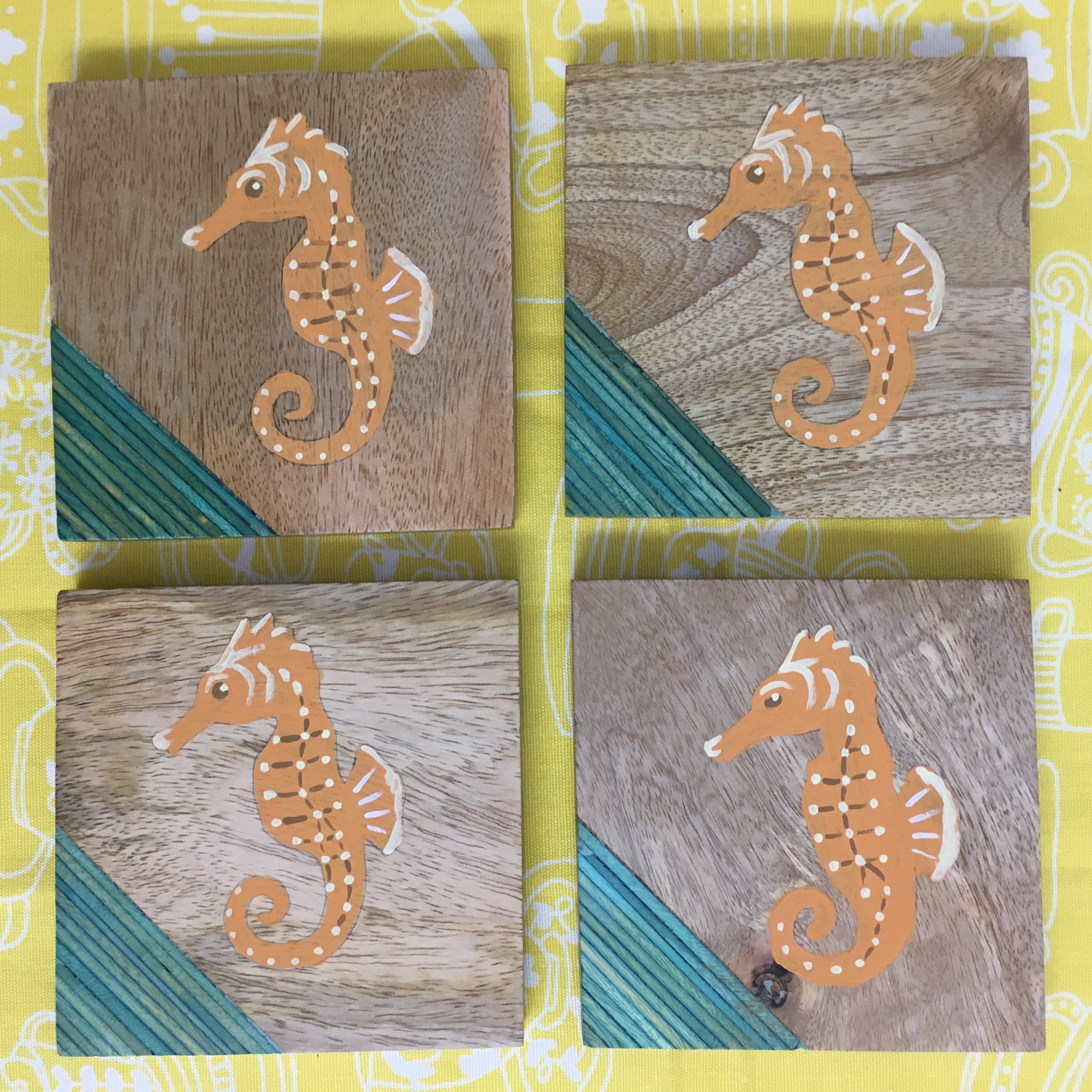 4.5 inch Seahorse Coaster Set - Keeping your table protected from moisture from glasses never looked so pretty! This set of four Seahorse coasters features a decorative sea-green striped inset on wood coasters with skid proof feet. Painted with milk paint and sealed with hard coat. These coasters are for decorative purposes only and not suitable for direct food contact. Wipe clean with a damp cloth, do not soak or put in the dishwasher.$25, plus sales tax and shipping