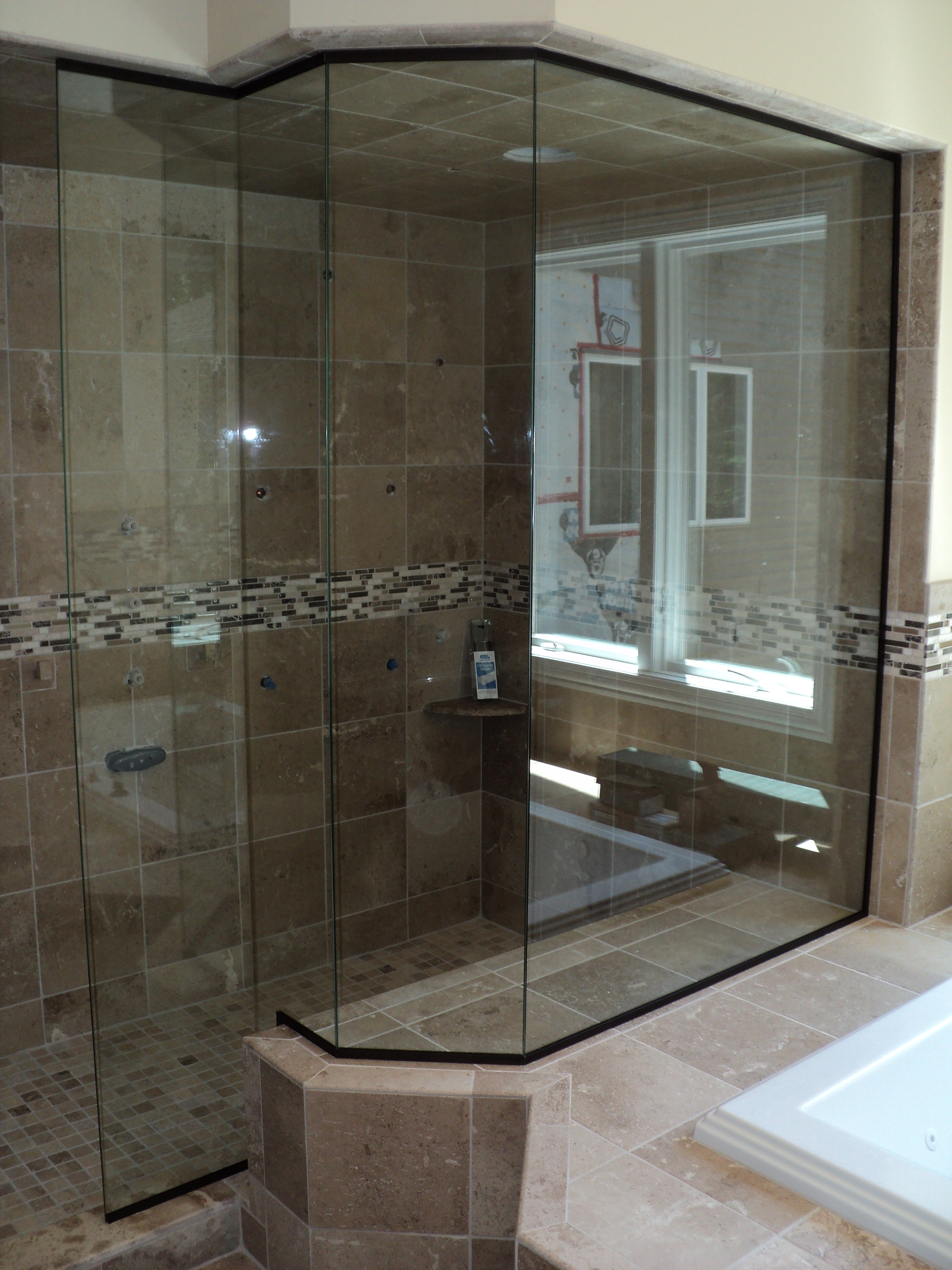 Oil rubbed bronze framing, clear glass.