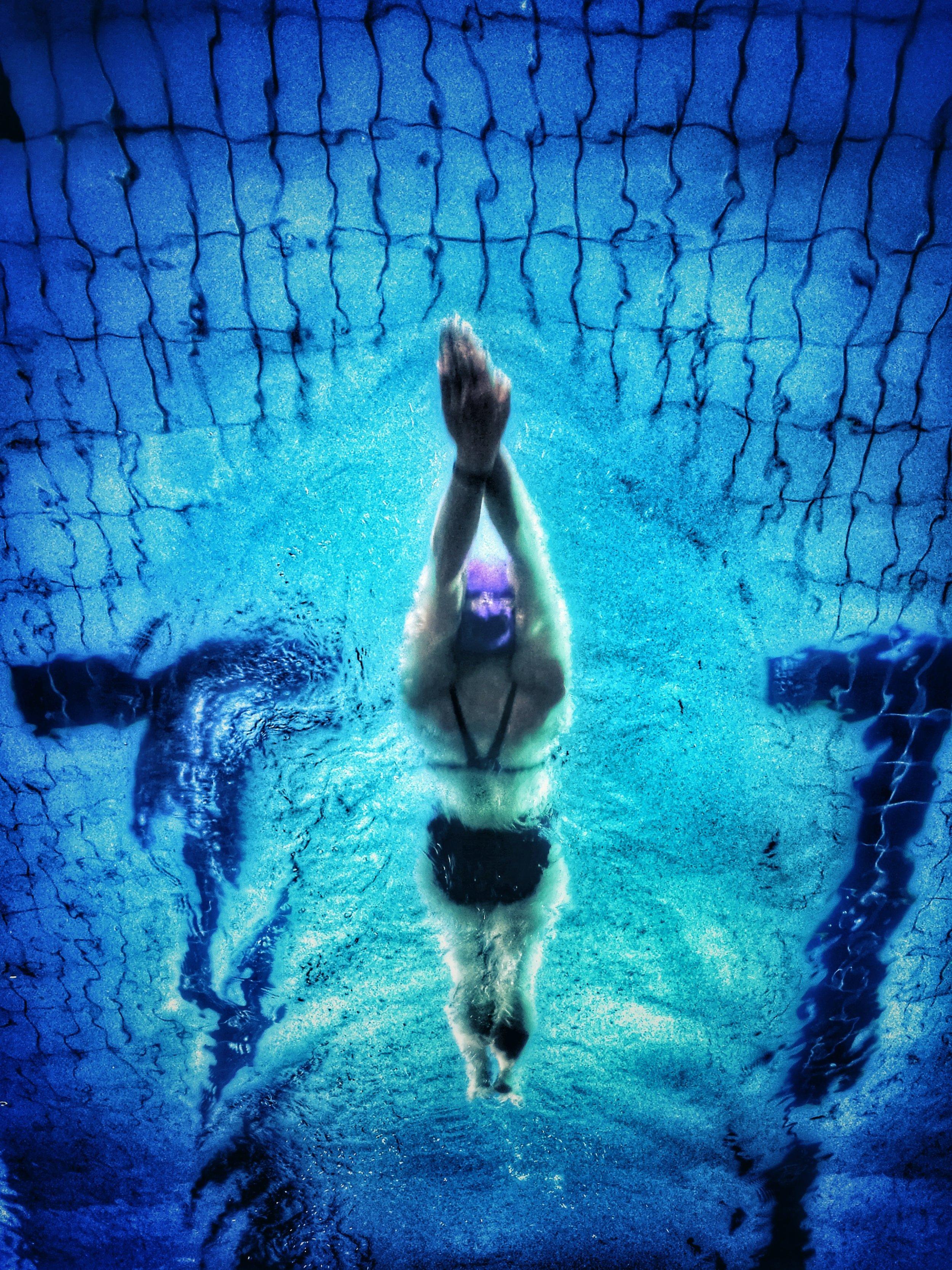 Triathlete swimming preparing for a triathlon in the pool