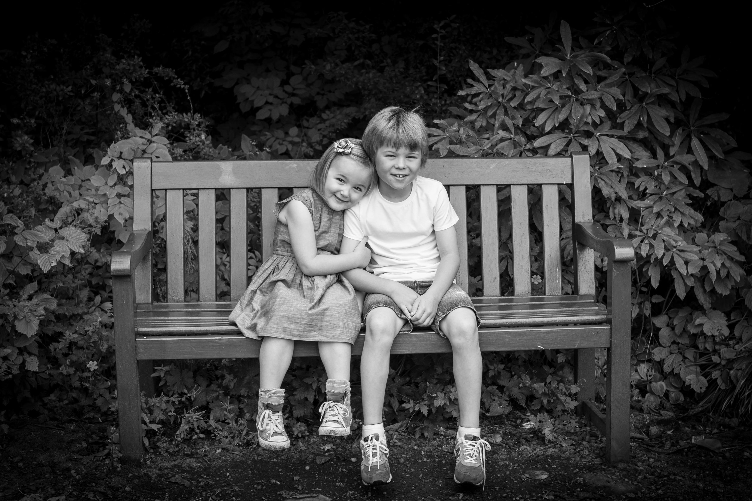 siblings on bench in park family photography paisley near glasgow