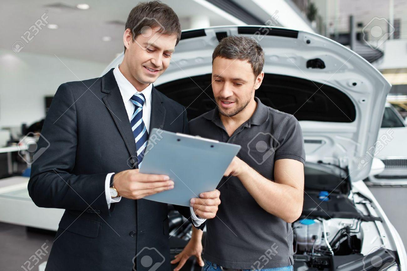 15896000-Young-man-buys-a-car-Stock-Photo-car-service-customer.jpg