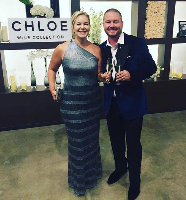 Kara with husband Matt during Fashion X Dallas closing night. Kara is wearing custom One Shoulder Gown