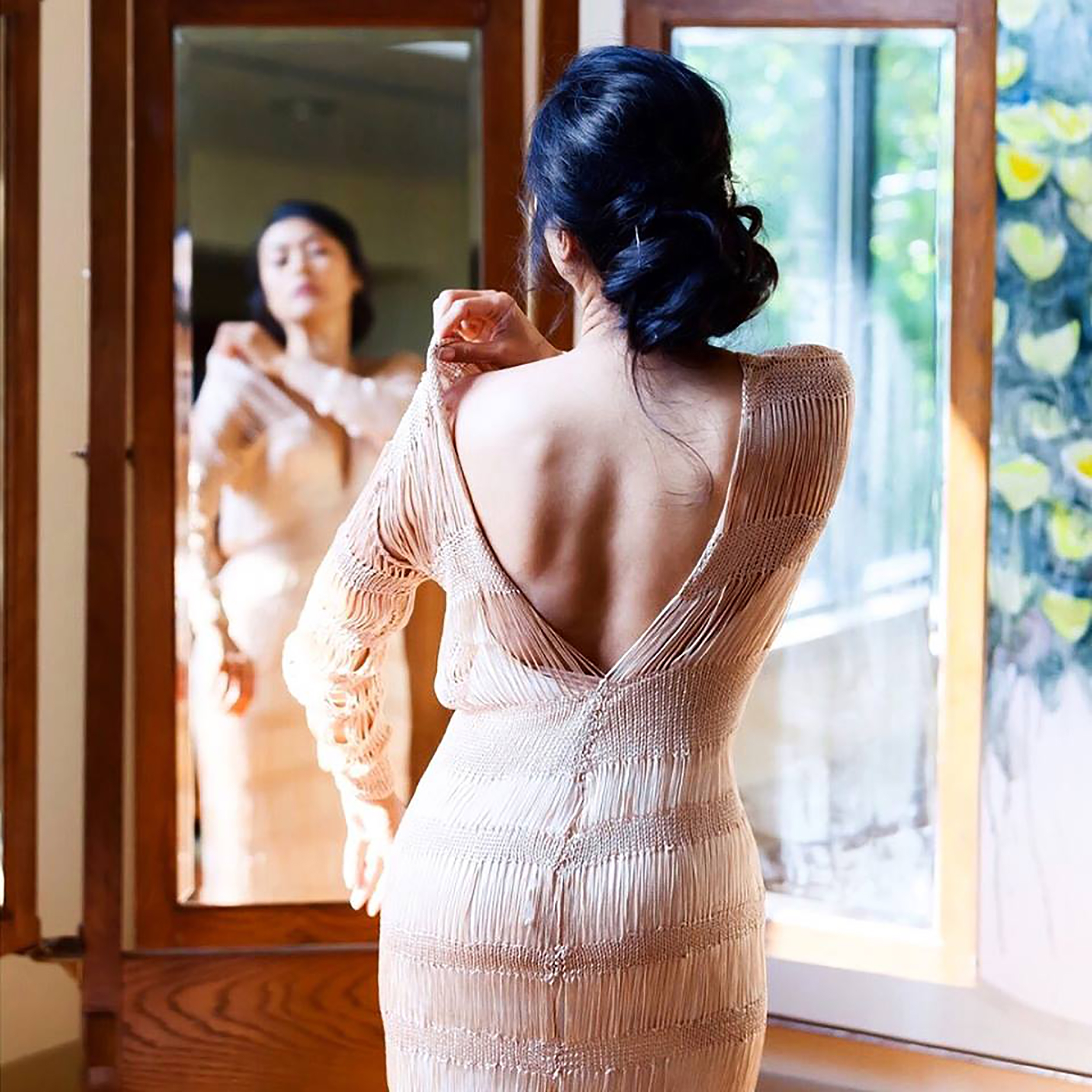 Kim on her wedding day. custom designed long sleeve gown in champagne color
