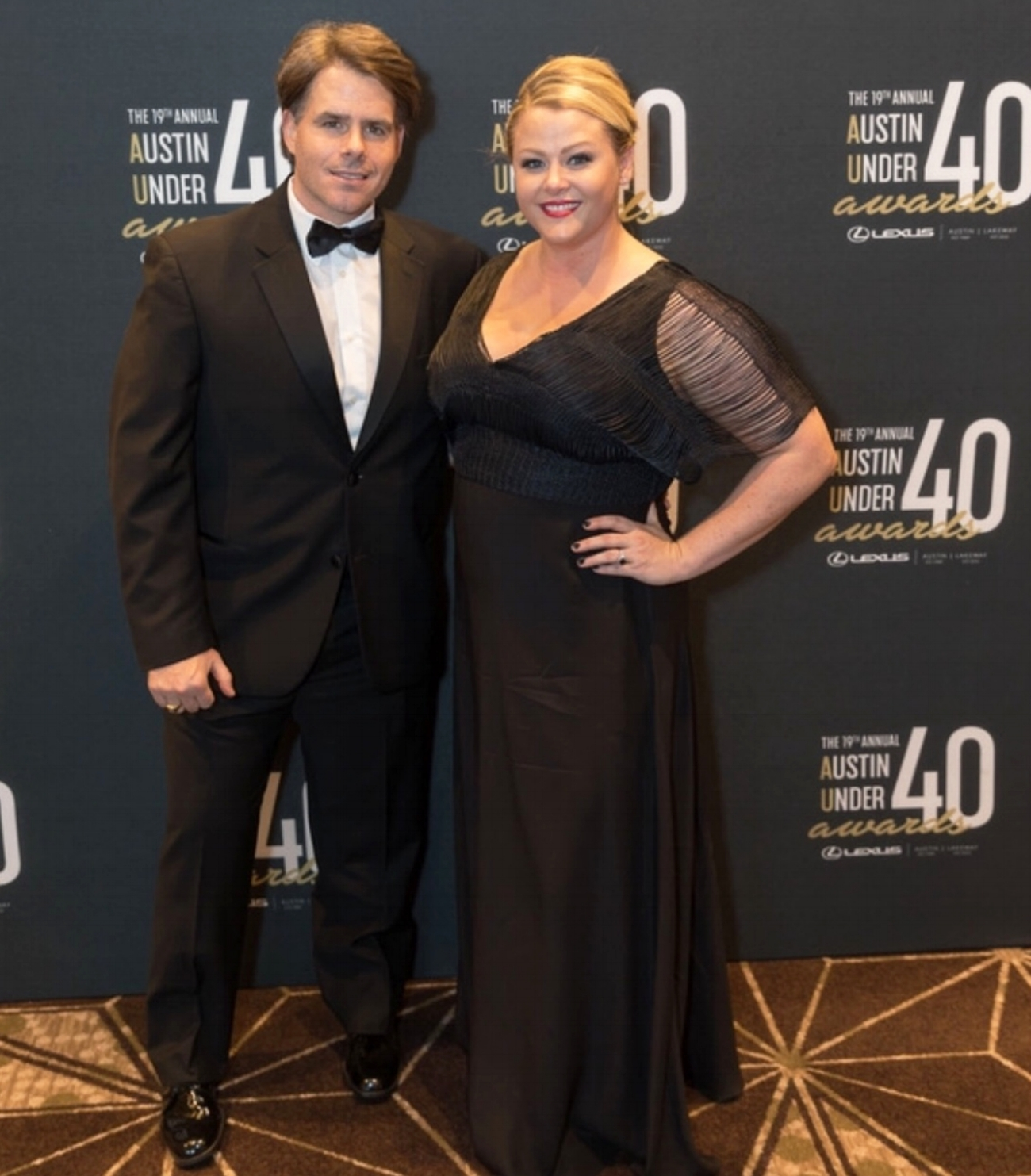 jessica and her husband mike at 'austin under 40' gala. jessica is wearing custom mod gown