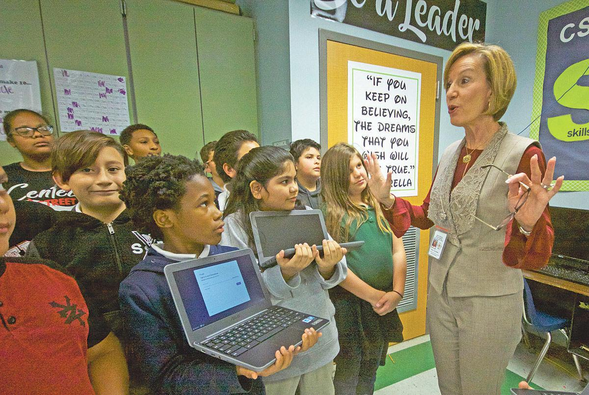 Iberia Parish Superintendent of Schools Carey Laviolette talks to students Thursday afternoon at Center Street Elementary School after the received new Chromebook computers from the BlueFin Group.