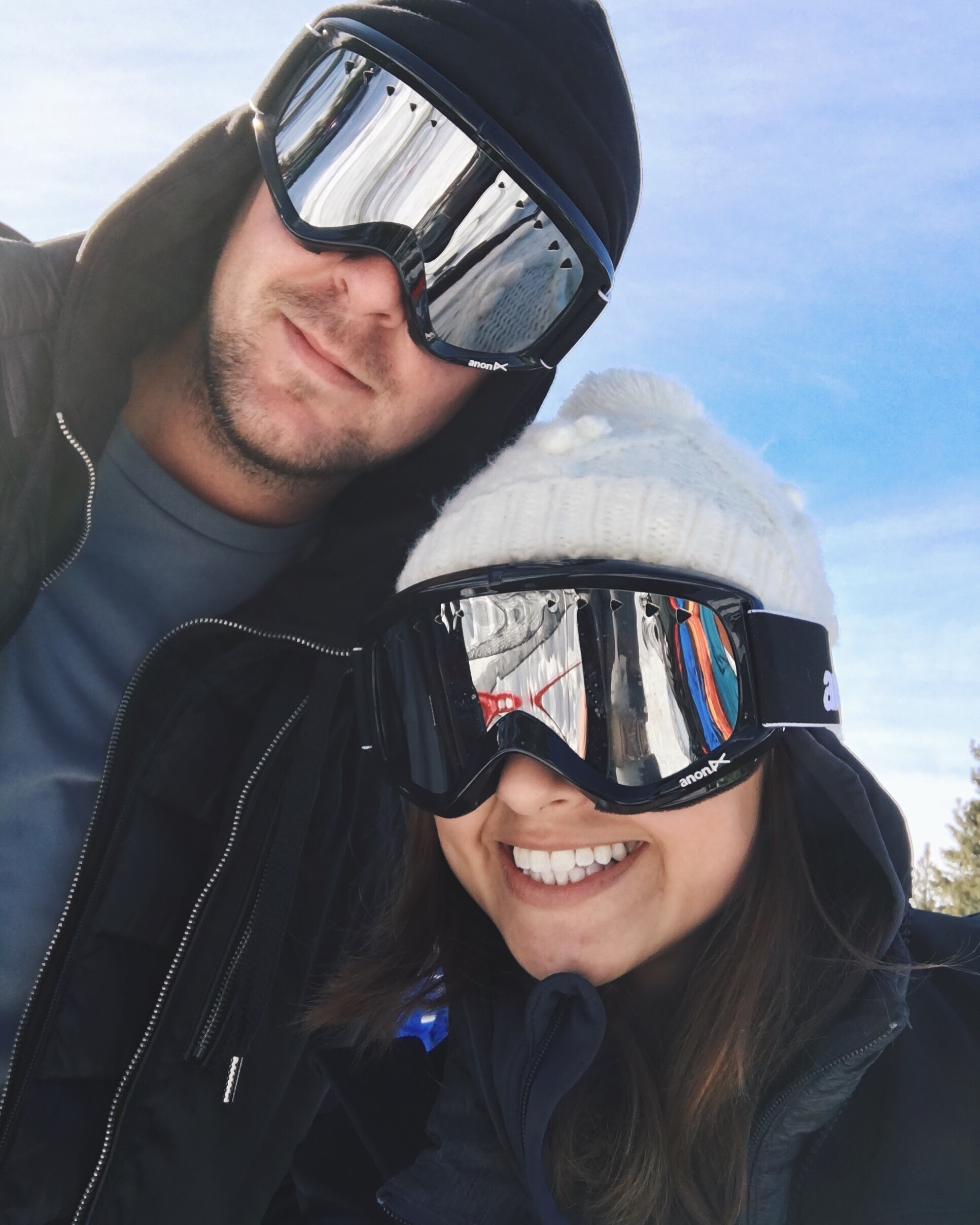 Me hiding my shame behind mirrored goggles, still smiling though. Alex is determined to teach me how to ski.