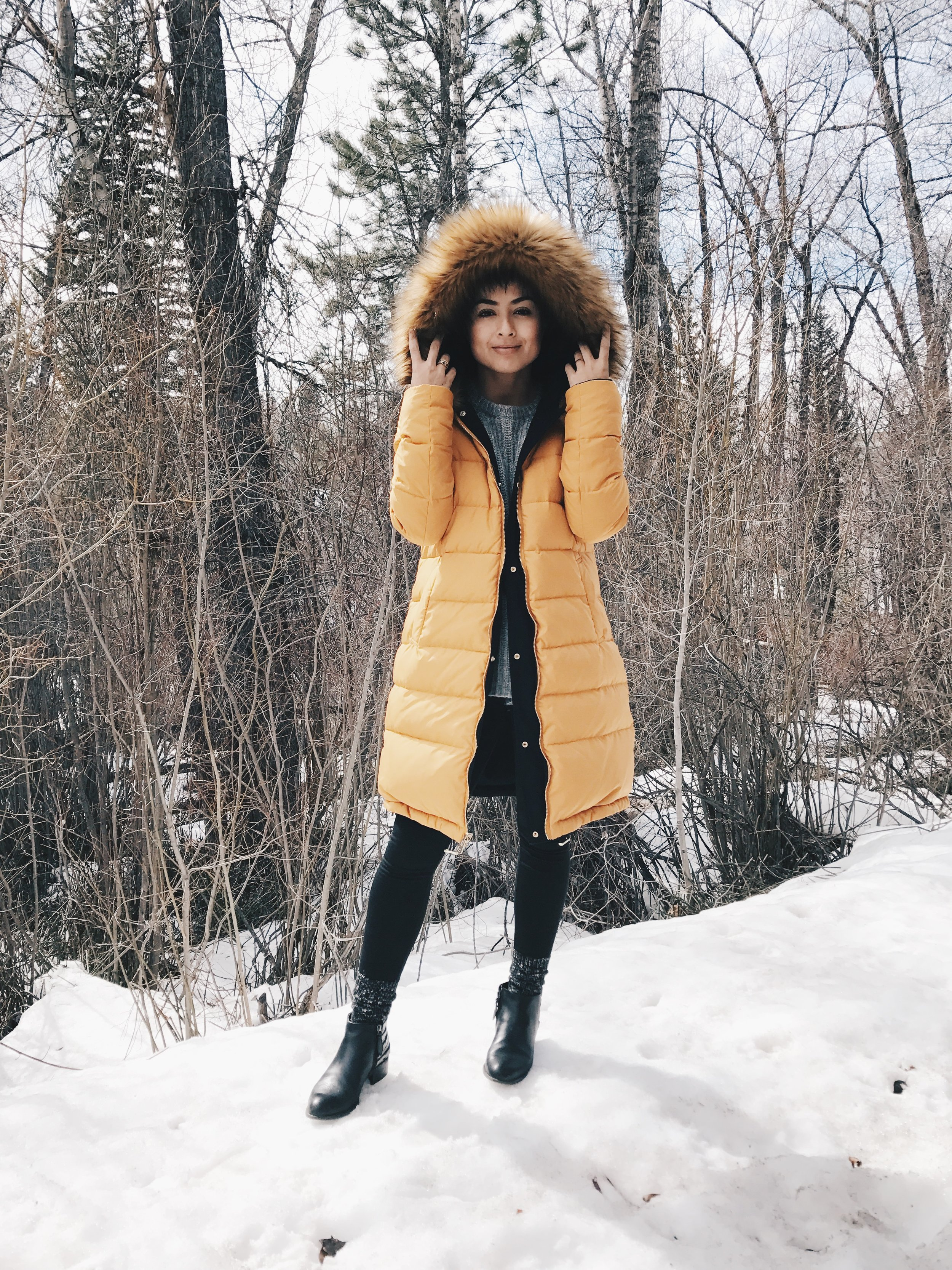 The snow might lead you to believe it was cold, but it was not bad. I wore this jacket because I bought it for Aspen-I had to wear it. Also, it's mustard yellow and I love it.