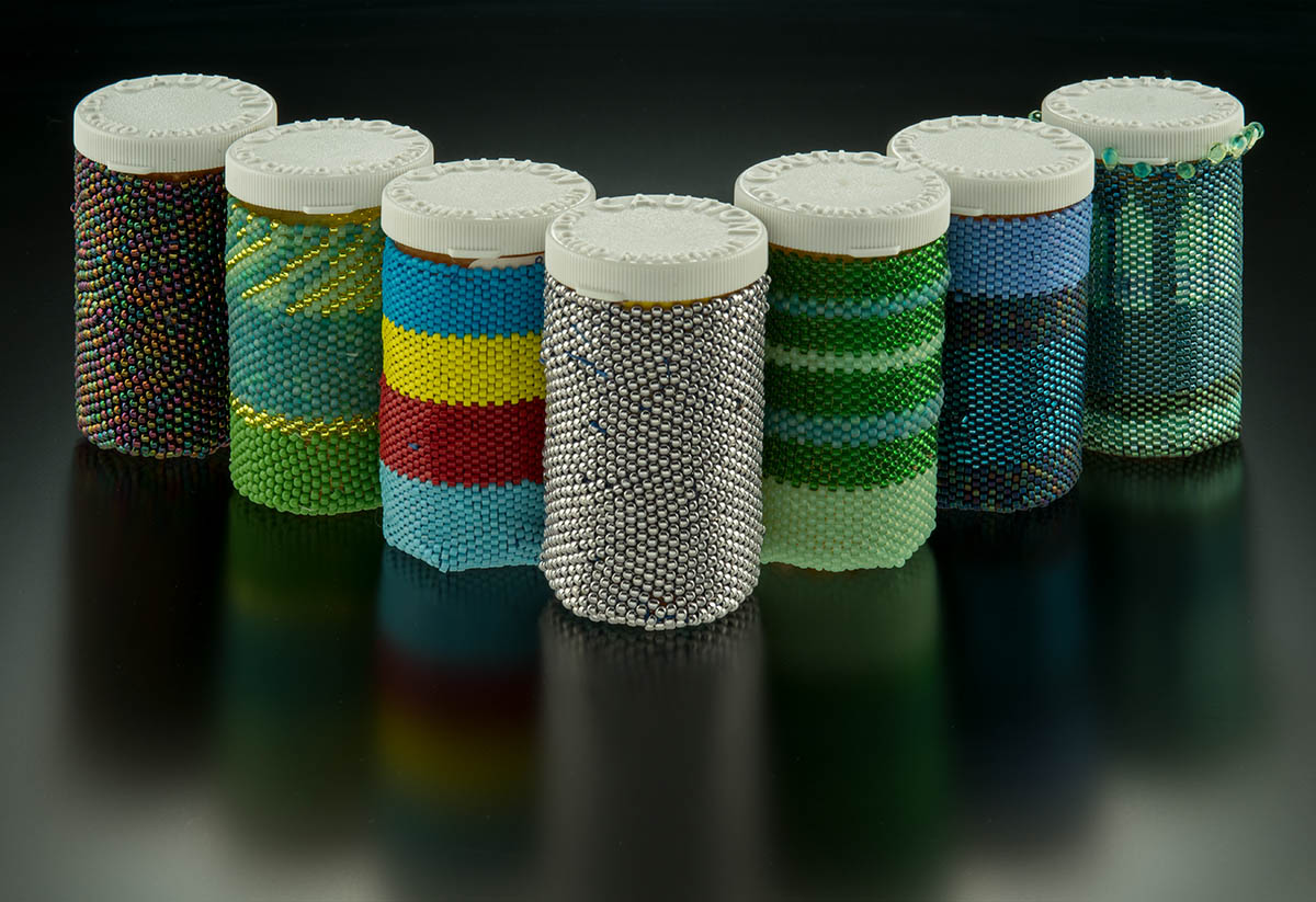 Medicine Man, 2015 and ongoing, beaded prescription bottles, photo Larry Sanders.