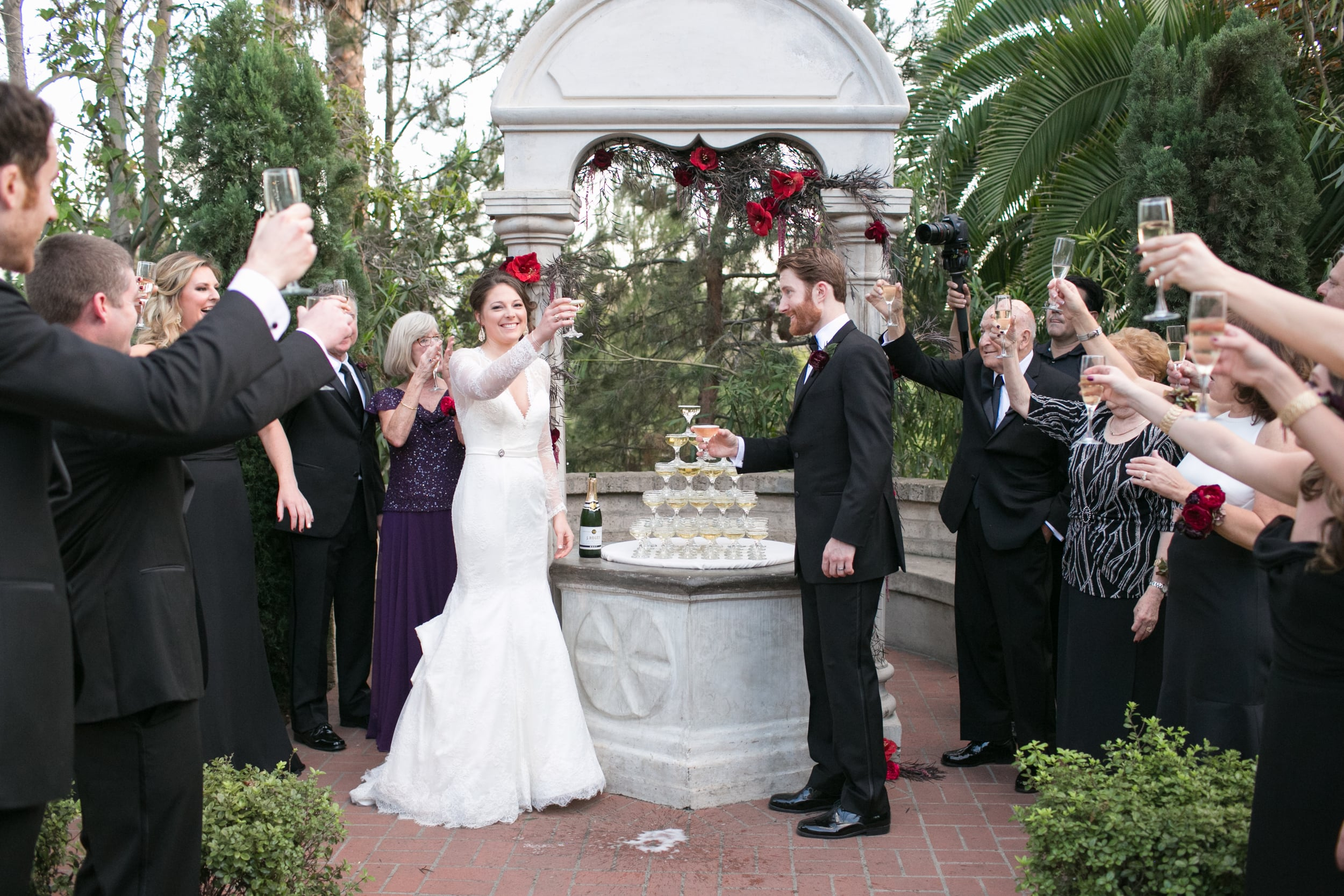 WeddingToastingRedAccentsSanDiegoWeddingPhotographyShewandersPhotography.jpg