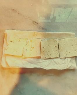 Slice tofu then press between paper towels