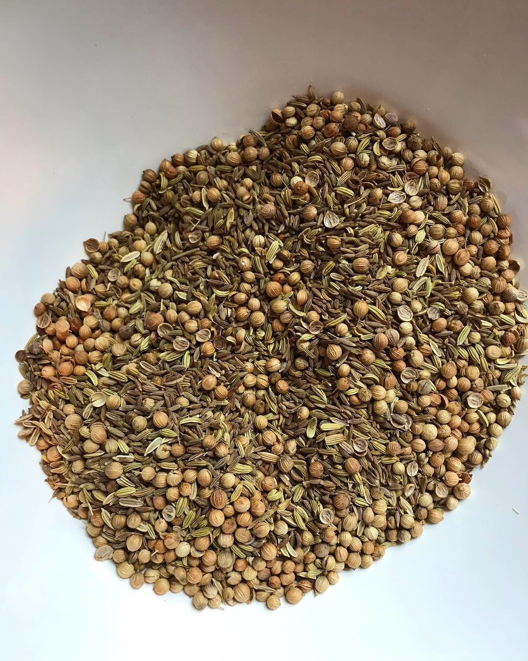 whole seeds, roasted then ground and mixed with friends like ground turmeric.