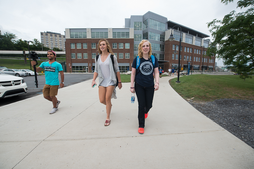 Ginny walks with Maddy Gardner, 20, a junior, left, on her first day of instruction for the fall semester at WVU on Wednesday, Aug. 17, 2016.