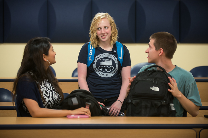 Ginny talks to Aishwarya Vijay, 18, left, and Skyler Roth, 19, right, in an Intro to Electrical Engineering class on her first day of instruction for the fall semester at WVU on Wednesday, Aug. 17, 2016.