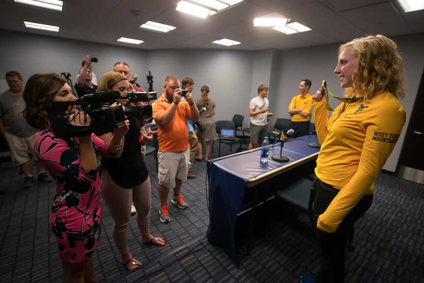 Ginny gets photographed by the media during a press conference at the campus on Wednesday, Aug. 17, 2016.