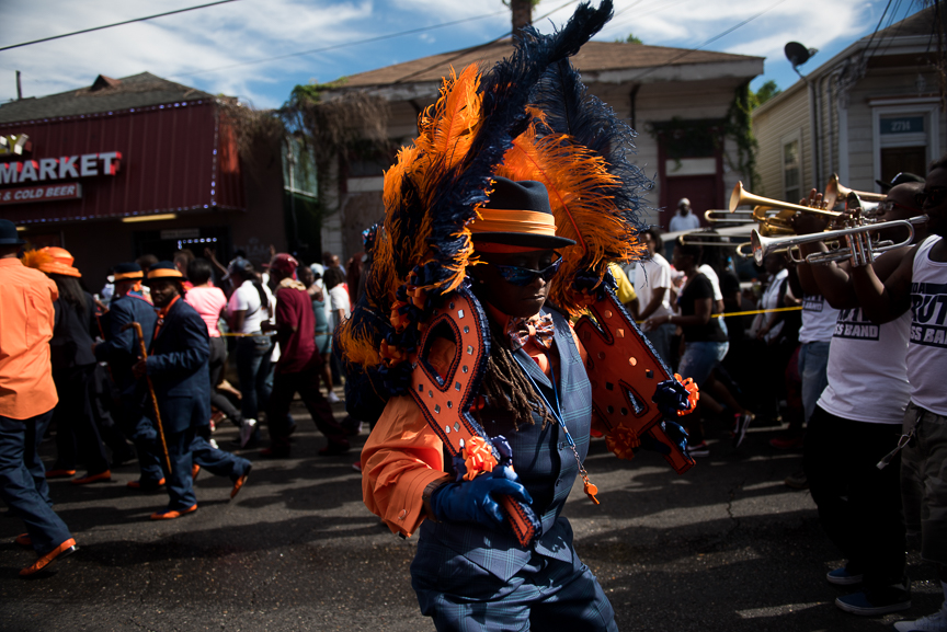 The Prince of Wales second line parade makes its way down a street of New Orleans' Irish Channel neighborhood on Oct. 9, 2016.