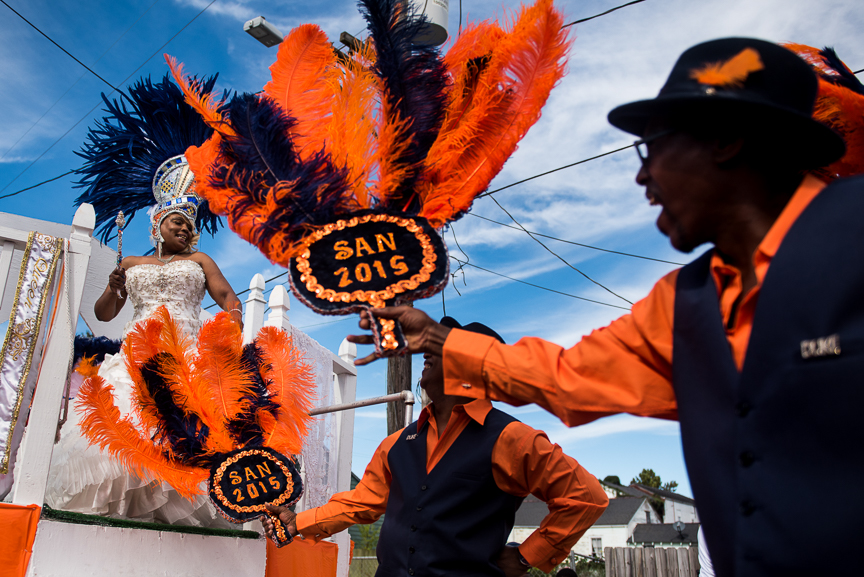 Men dance on a float with Queen Terry during the Prince of Wales second line parade in New Orleans on Oct. 9, 2016.