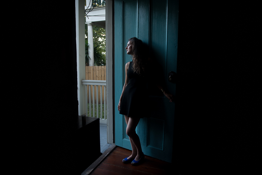 Steph looks out of the door of our Airbnb in New Orlean's Garden District.