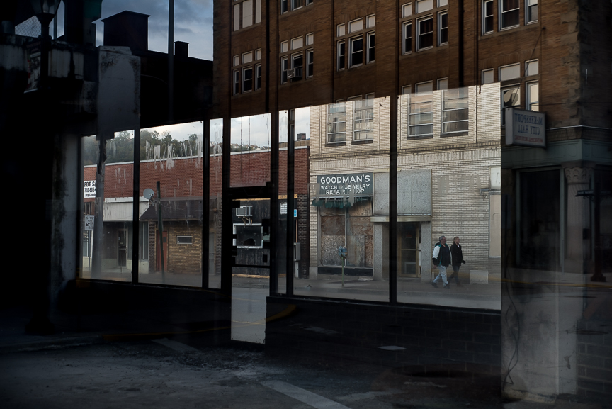 Vacant business are reflected in an empty storefront in McKeesport, Pa., on Oct. 25, 2016.