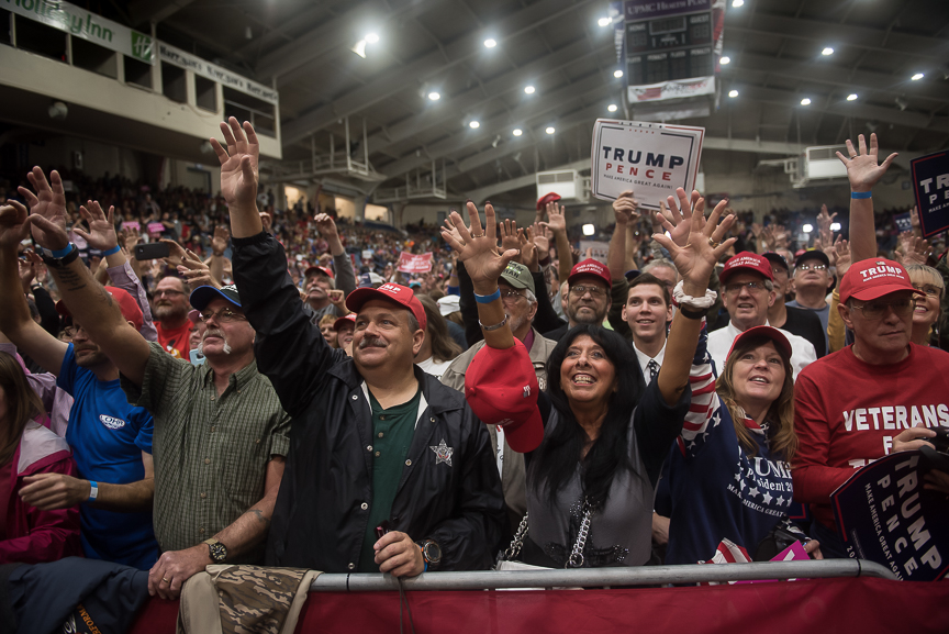 Donald Trump supporters cheer at a campaign stop at the Cambria County War Memorial Arena on October 21, 2016 in Johnstown, Pennsylvania. Trump and Democratic presidential nominee Hillary Clinton continue to campaign as Election Day nears.