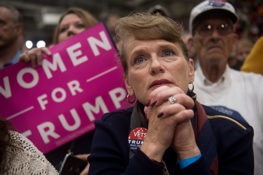 A supporter of Republican presidential candidate Donald Trump listens on as he speaks during a campaign stop at the Cambria County War Memorial Arena on October 21, 2016 in Johnstown, Pennsylvania.