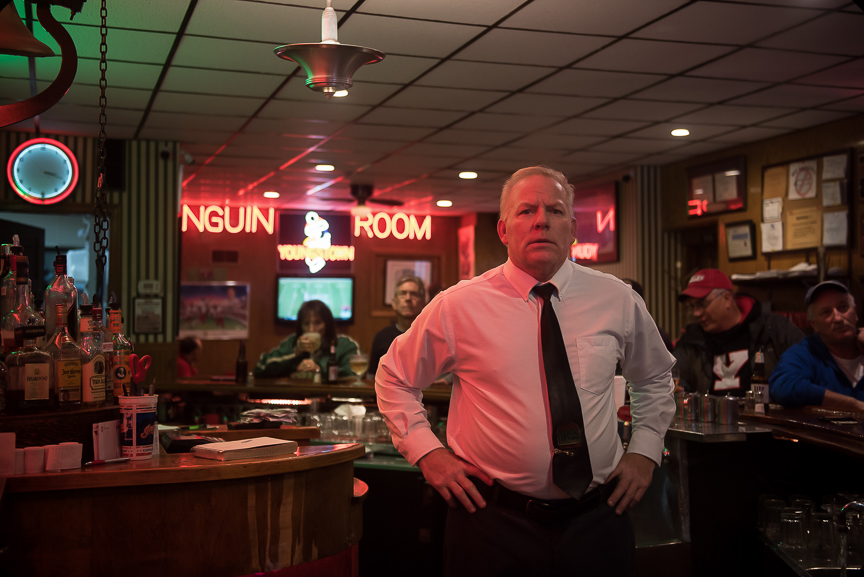 Phillip Naples stands behind the bar at the Golden Dawn in Youngstown, Ohio on Nov.19, 2016.