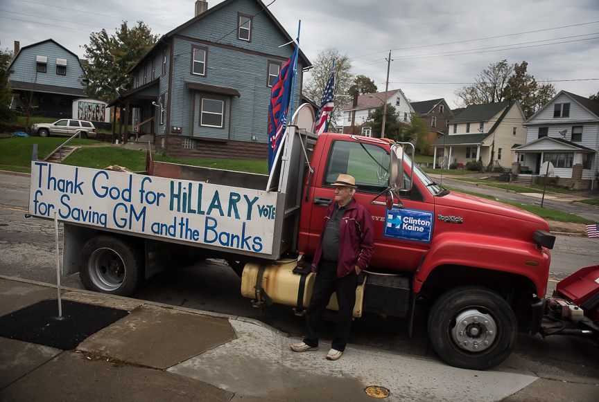 Carl Venzeio, 77, a self-proclaimed supporter of Democratic presidential nominee Hillary Clinton, stands in front of his trunk in Youngstown, Ohio on Oct. 26, 2016.