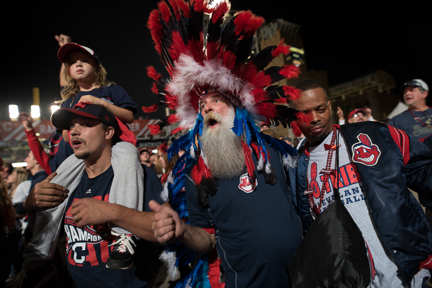 Paul Hollo of Cleveland wears his Indian headgear as he cheers on the Indians outside of Progressive Field during game 6 of the World Series on November 1, 2016 in Cleveland, Ohio.