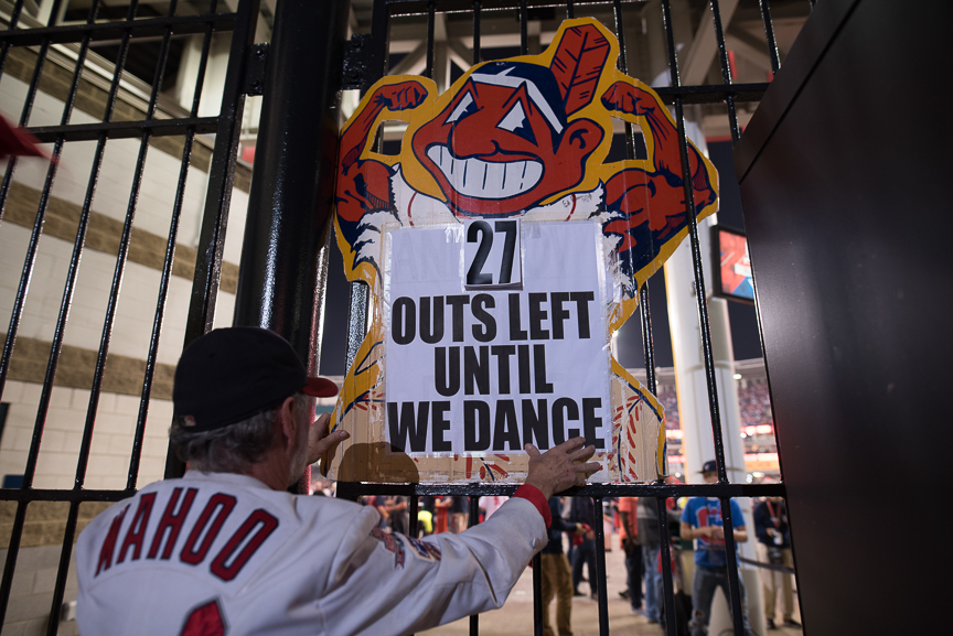 Jim Stamper of Cleveland hangs a sign outside of Progressive Field during game 6 of the World Series on November 1, 2016 in Cleveland, Ohio.