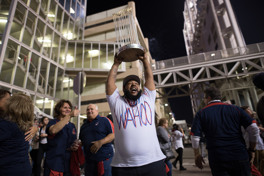 Demilles Jones, 35, of Cleveland holds a homemade World Series trophy outside of Progressive Field during game 6 of the World Series on November 1, 2016 in Cleveland, Ohio.