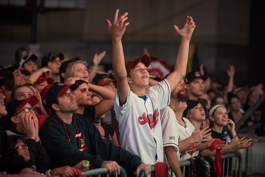 Fan react as the Cleveland Indians give up 3 runs in the the first inning as they watch on a big screen outside of Progressive Field during game 6 of the World Series on November 1, 2016 in Cleveland, Ohio.