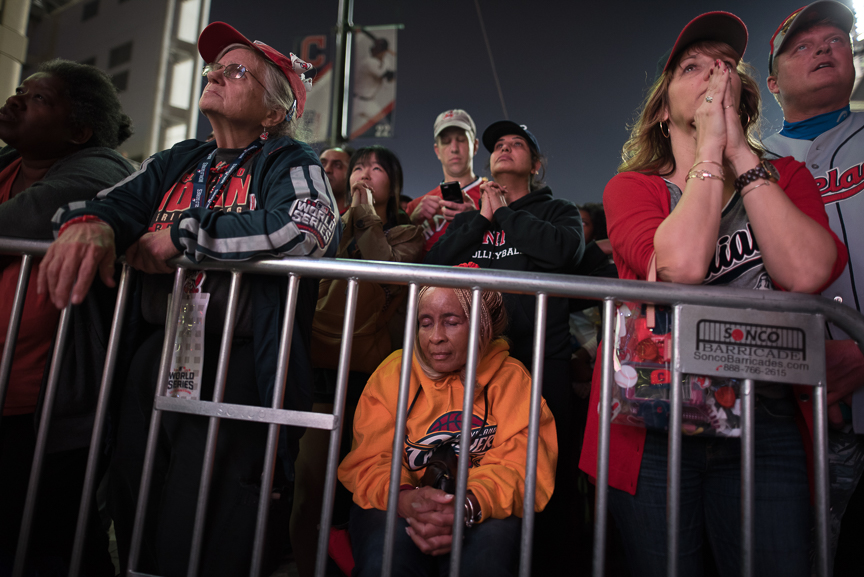 Fans react as they watch the big screen outside of Progressive Field during game 7 of the World Series between the Cleveland Indians and the Chicago Cubs on November 2, 2016 in Cleveland, Ohio.